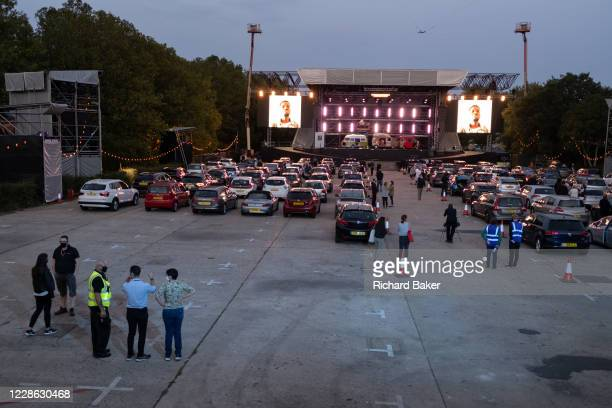 The car park fills up before the technical rehearsal of Puccini's La bohème is performed by members of English National Opera as a drivein at...