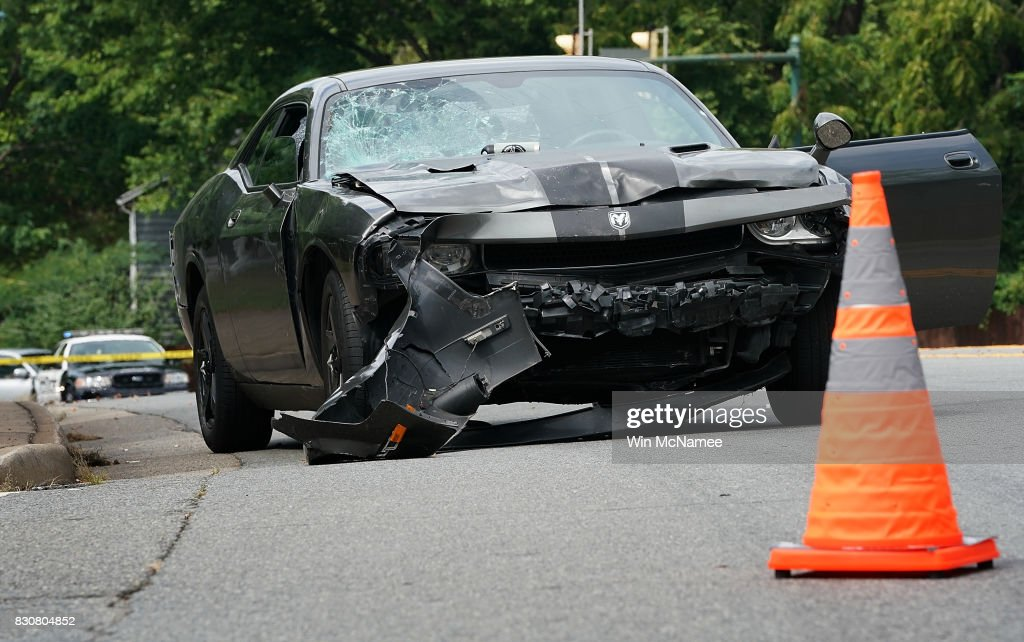 The car that allegedly plowed through a crowd of protestors marching through a downtown shopping district is seen after the vehicle was stopped by police several blocks away August 12, 2017 in Charlottesville, Virginia. The car allegedly plowed through a crowd, and at least one person has died from the incident, following the shutdown of the 'Unite the Right' rally by police after white nationalists, neo-Nazis and members of the 'alt-right' and counter-protesters clashed near Emancipation Park, where a statue of Confederate General Robert E. Lee is slated to be removed.