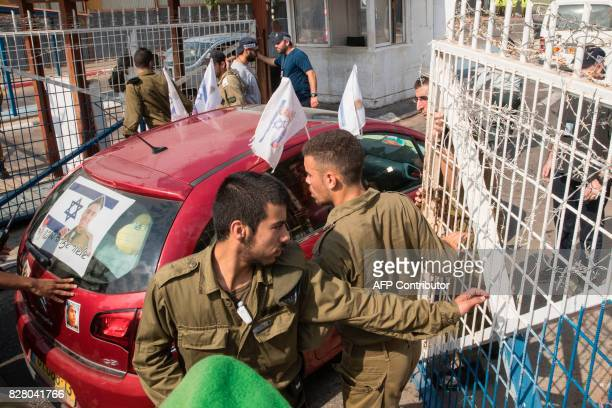 The car transporting Israeli soldier Elor Azaria who was convicted of manslaughter and sentenced to 18 months imprisonment for killing a wounded and...