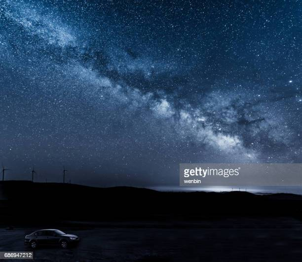 The car under the milky way arch