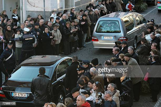 The car with the coffin of former Italian director Carlo Ponti pass through people who crowded San Martin church square on January 12 2007 in Magenta...