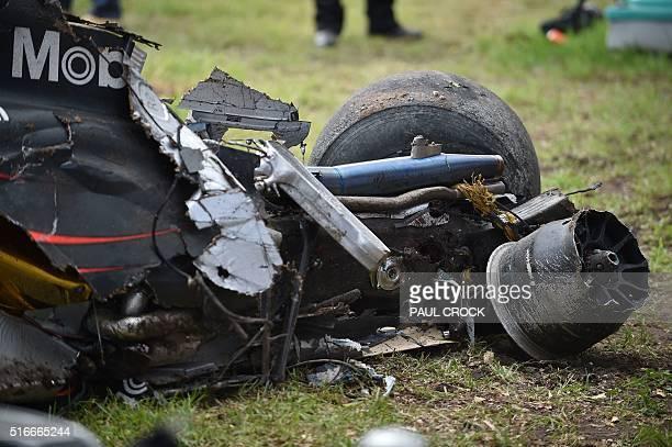 The car wreckage of McLaren Honda's Spanish driver Fernando Alonso is seen after he crashed with Haas F1 Team's Brazilian driver Esteban Gutierrez...
