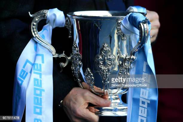 The Carabao Cup League Cup trophy is presented in Man City colours ahead of the Premier League match between Manchester City and Chelsea at the...