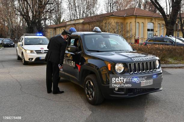 The carabinieri escort the Pfizer-BioNTech COVID-19 vaccine outside the Amedeo di Savoia ward in Turin on December 27, 2020 in Turin, Italy. The...