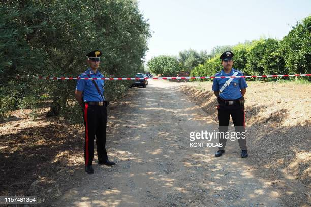 The Carabinieri on the site of the mafia ambush in Calabria where two men were shot to death. The victims are a special security guard, for crimes of...
