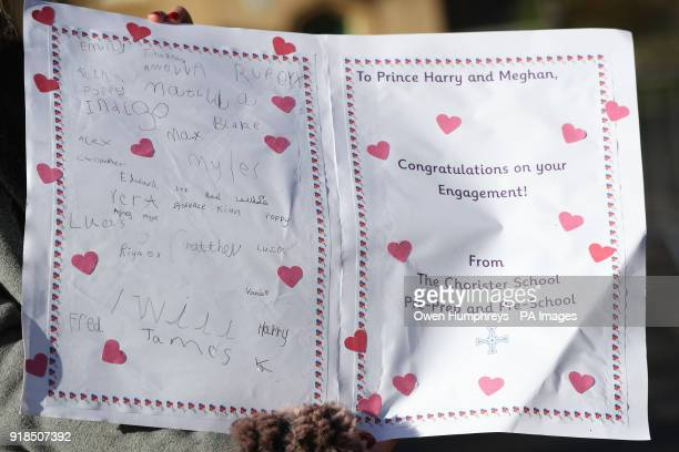 The card given to the Prince of Wales for Prince Harry and Meghan Markle from pupils at the Chorister School as he arrives for a visit to the Open...