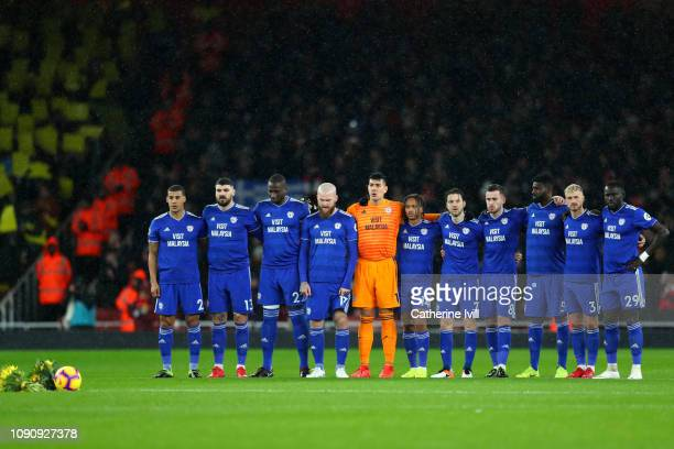 The Cardiff City team take part in a minute of silence in tribute to Emiliano Sala prior to the Premier League match between Arsenal and Cardiff City...