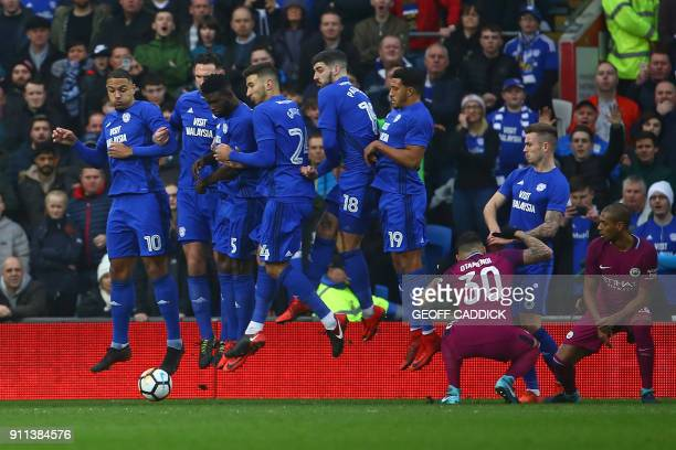 The Cardiff City wall jump as Manchester City's Belgian midfielder Kevin De Bruyne passes the ball under them to score the opening goal during the...