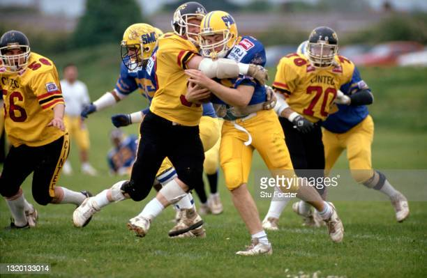 The Cardiff Mets defence makes a play during a Coca Cola UK American Football League match on May 26th 1991 in Cardiff, United Kingdom.