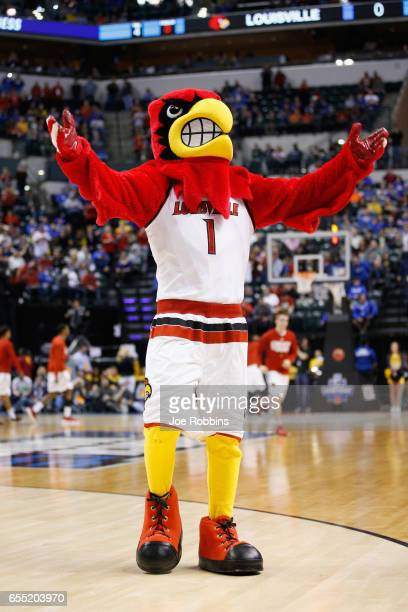 The Cardinal Bird mascot for Louisville Cardinals performs before the game against the Michigan Wolverines in the first half during the second round...