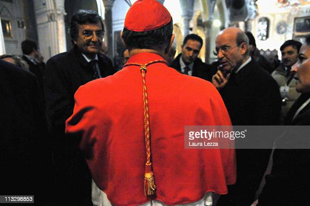 The Cardinal of Naples Crescenzio Sepe speaks with representatives of the civil authorities after the ceremony on the day of the blood miracle at...