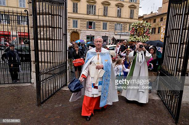 The cardinal Vincent Gerard Nichols with umbrella Archbishop of Westminster and President of the Catholic Bishops' Conference of England and Wales...