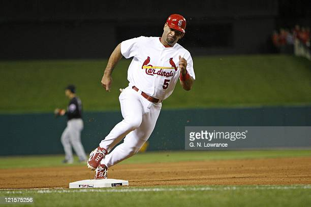 The Cardinals Albert Pujols rounds third base on his way to score the games only run during 6th inning action between the New York Mets and the St...