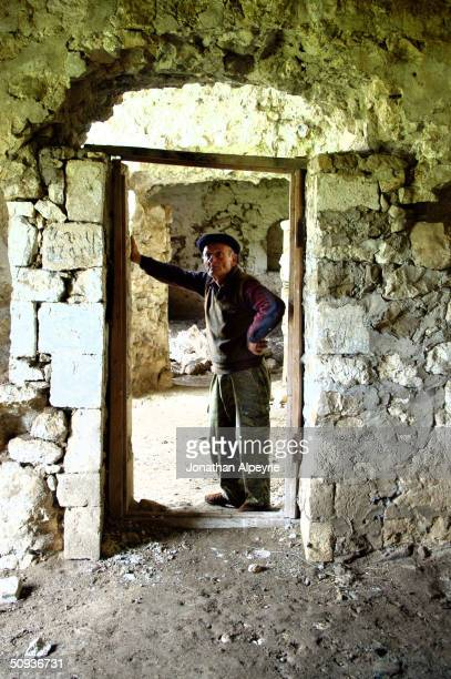 The care taker of Asmaras monastery, for 20 years, stands inside what used to be the 4th century religious school next to the monastery May 4, 2004...