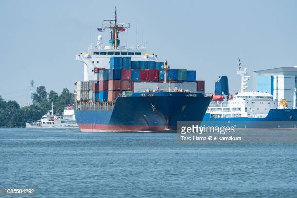 The cargo sailing on Chao Phraya River in Samut Prakan Province in Thailand