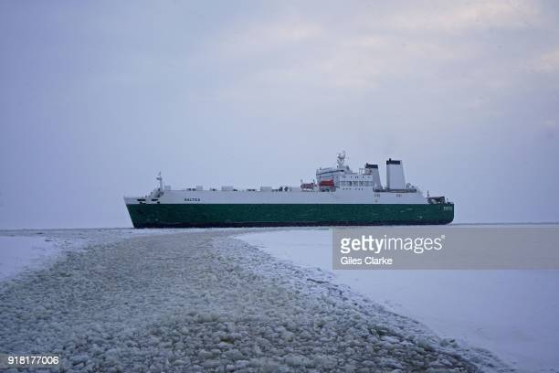 """The cargo ship """"Baltica' navigating the recently opened ice channel into Kemi port. The 'Sampo' is an Ice-breaker that was built in 1961 by the..."""