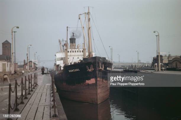 The cargo ship Ramsdal passes through Barton Locks on the Manchester Ship Canal near Eccles in Manchester, England circa 1960.
