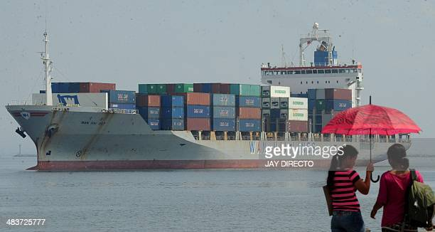 The cargo ship Wan Hai arrives at Manila's international container port on April 10, 2014. Philippine exports surged at their fastest pace in more...