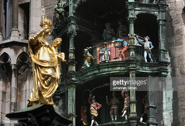 The carillon of the new townhall at the Marienplatz is seen on March 23 2007 in Munich Germany The carillon refered to locally as a Glockenspiel will...