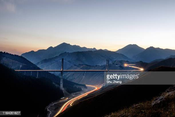 the carlight trail in the road and bridge - transport stock pictures, royalty-free photos & images