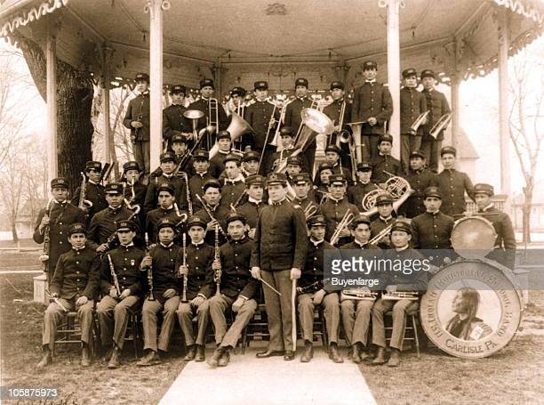 The Carlisle Indian School music band posed in their uniforms at the bandstand Carlisle PA 1901