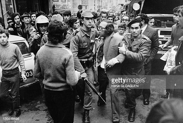 The carnation revolution in Lisbon Portugal in May 1 1974 Arrest of a man a policeman of the former regime or a collaborator