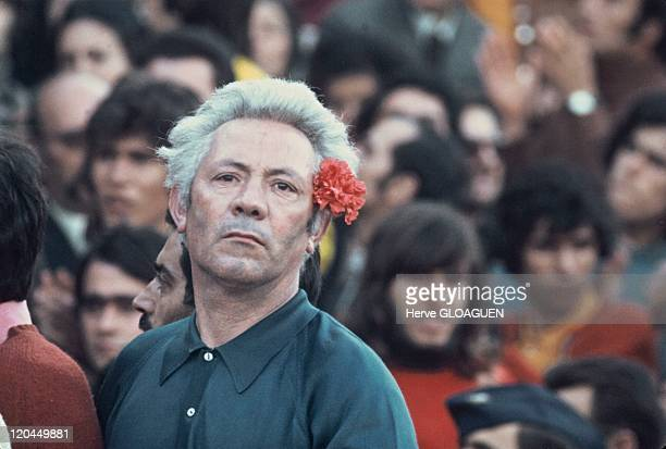 The carnation revolution in Lisbon Portugal in May 1 1974 People celebrate the pacific revolution by wearing a carnation