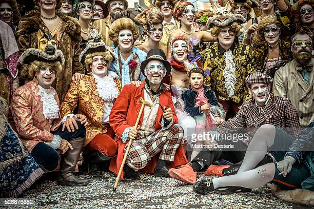The 'Carnestoltes' fictitious Catalan figures leading all carnival activities gather for a photo at the end of the children carnival parade in Sitges