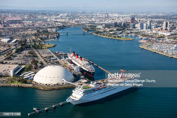 The Carnival Airship flies over the Queen Mary top and the cruise ship Carnival Imagination bottom in Long Beach on Thursday January 10 2019 to mark...