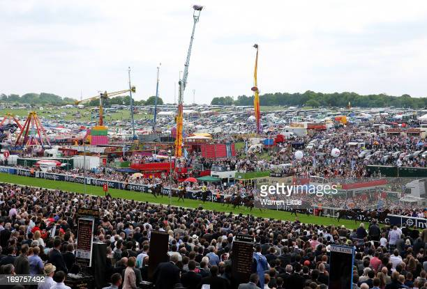 The carnival continues as The Investec Out Of The Ordinary Stakes is run during The Derby Festival at Epsom Racecourse on June 1, 2013 in Epsom,...