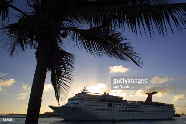 The Carnival Corp cruise ship Fascination sets sail December 17 2001 in Miami Florida Setting the stage for a battle of the cruiseship giants PO...