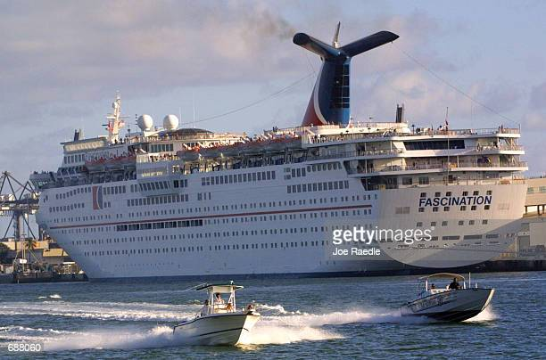The Carnival Corp cruise ship Fascination sits at a slip December 17 2001 in Miami Florida Setting the stage for a battle of the cruiseship giants PO...