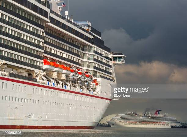 The Carnival Corp Miracle and Panorama cruise ships sit acnhored at the Port of Long Beach in Long Beach California US on Monday April 13 2020 The...