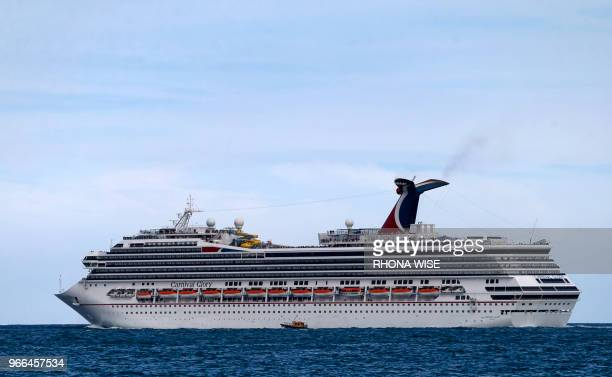The Carnival Cruise Ship 'Carnival Glory' heads out to sea in the Miami harbor entrance known as Government Cut in Miami Florida June 2 2018