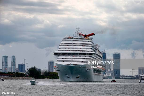 The Carnival Cruise Ship 'Carnival Vista' heads out to sea in the Miami harbor entrance known as Government Cut in Miami Florida June 2 2018