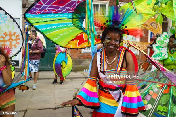 The Carnival Queen at the Derby Caribbean Carnival 2013. Wearing a colourful striped spiral costume.