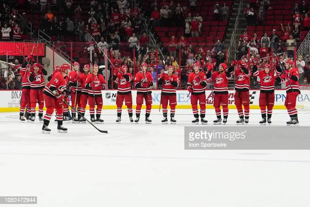 The Carolina Hurricanes applaud the fans in the Storm Surge after a game between the Vancouver Canucks and the Carolina Hurricanes at the PNC Arena...
