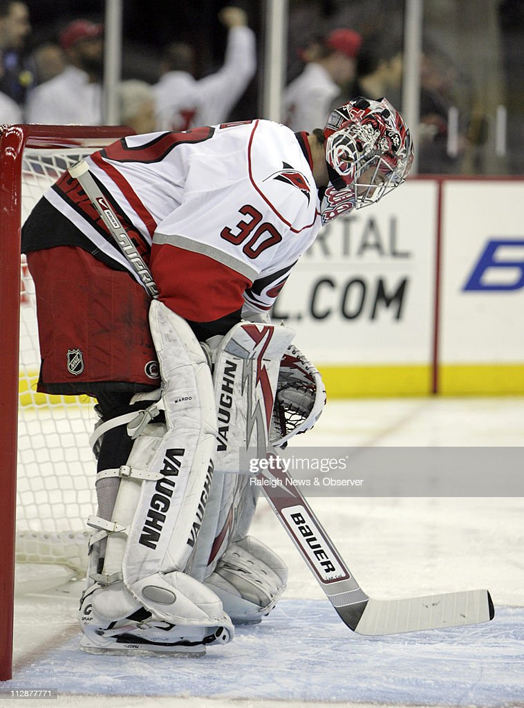 fae59300f The Carolina Hurricanes  Cam Ward (30) hangs his head after giving up the