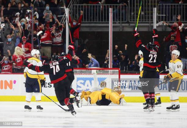 The Carolina Hurricanes celebrate after scoring the winning goal against the Nashville Predators in overtime in Game Five of the First Round of the...