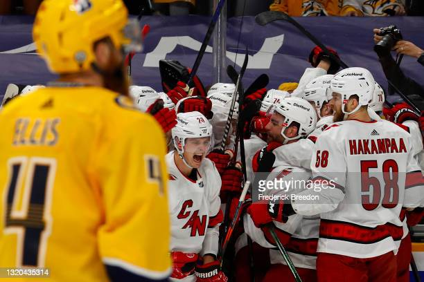 The Carolina Hurricanes celebrate after their 4-3 overtime victory against the Nashville Predators in Game Six of the First Round of the 2021 Stanley...
