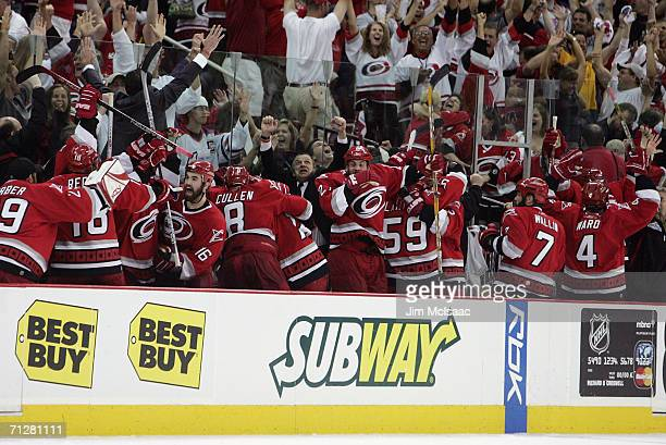 The Carolina Hurricanes celebrate on the bench after their teams third goal against the Edmonton Oilers during game seven of the 2006 NHL Stanley Cup...