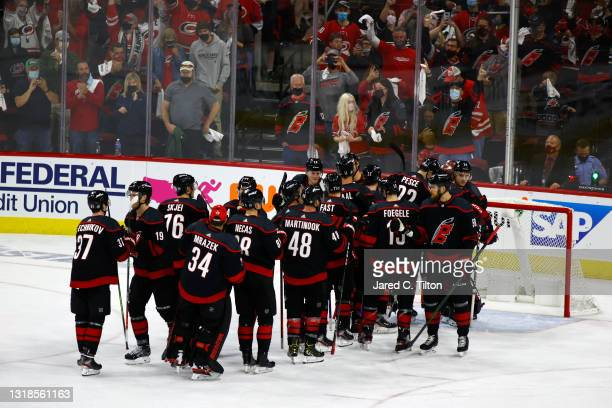 The Carolina Hurricanes celebrate their victory against the Nashville Predators following Game One of the First Round of the 2021 Stanley Cup...