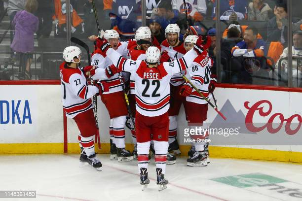 The Carolina Hurricanes celebrate their win in overtime over the New York Islanders during Game One of the Eastern Conference Second Round during the...