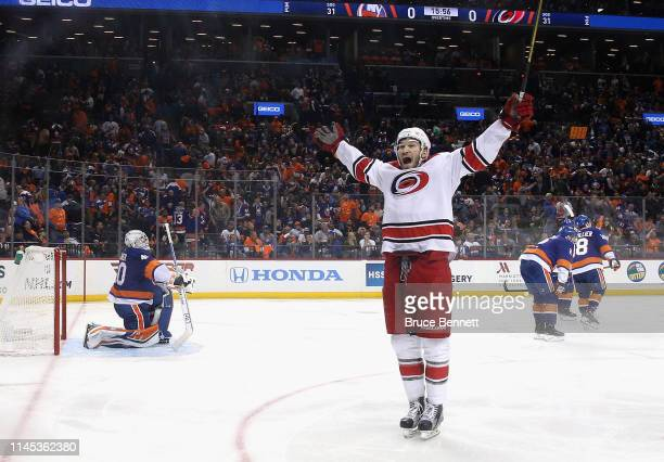 The Carolina Hurricanes celebrates a 1-0 overtime win over the New York Islanders in Game One of the Eastern Conference Second Round during the 2019...