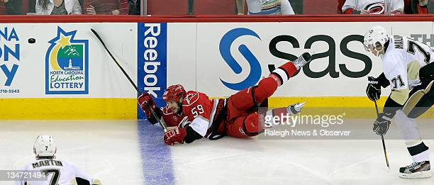 The Carolina Hurricanes' Chad LaRose and the Pittsburgh Penguins' Evgeni Malkin go for the puck during the second period of an NHL game at the RBC...