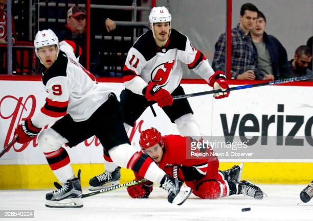 The Carolina Hurricanes' Derek Ryan and the New Jersey Devils' Taylor Hall and Brian Boyle all keep their eyes on the puck during the second period...