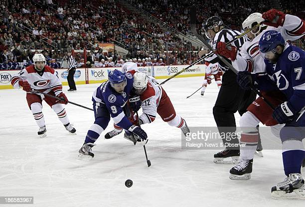 The Carolina Hurricanes' Eric Staal faces off against the Tampa Bay Lightning's Tyler Johnson while Hurricanes' Nathan Gerbe Elias Lindholm and the...