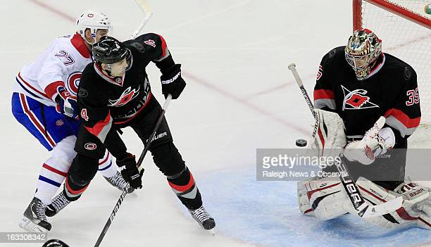 The Carolina Hurricanes' Jamie McBain and Justin Peters defend the goal against the Montreal Canadiens' Alex Galchenyuk during the second period at...