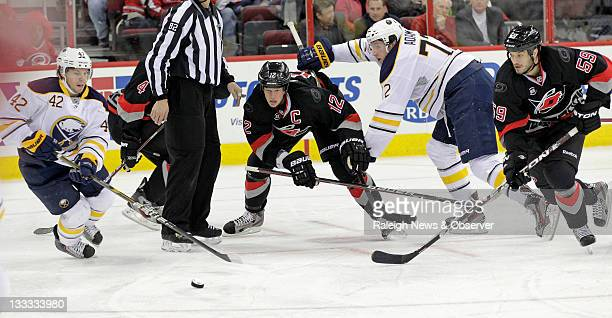 The Carolina Hurricanes' Jamie McBain , Eric Staal and Chad LaRose battle the Buffalo Sabres' Nathan Gerbe and Luke Adam for the puck during the...