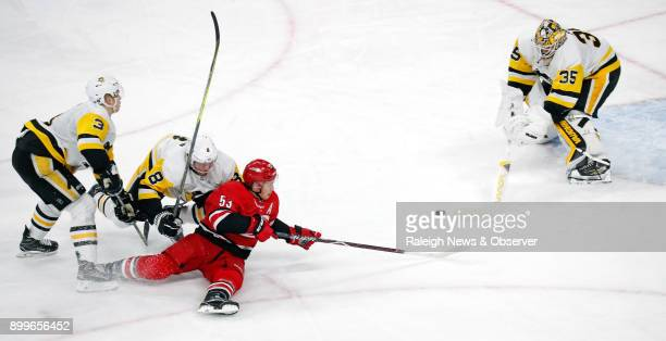 The Carolina Hurricanes' Jeff Skinner can't get the puck past the Pittsburgh Penguins' Tristan Jarry after driving through Olli Maatta and Brian...